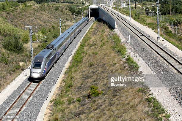 A TGV duplex highspeed train operated by Societe Nationale des Chemins de Fer passes through the northbound Perthus Tunnel in Perthus France on...