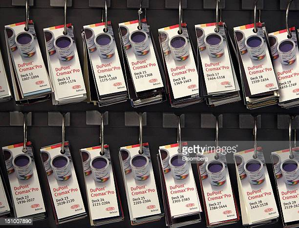 DuPont Co. Auto-paint chips hang in the paint room at Haydocy Automotive in Columbus, Ohio, U.S., on Thursday, Aug. 30, 2012. Carlyle Group LP, the...