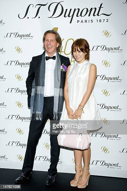 ST Dupont global CEO Alain Crevet and South Korean actress Son YeJin attend the 'ST Dupont' Seoul flagship store opening on July 3 2012 in Seoul...