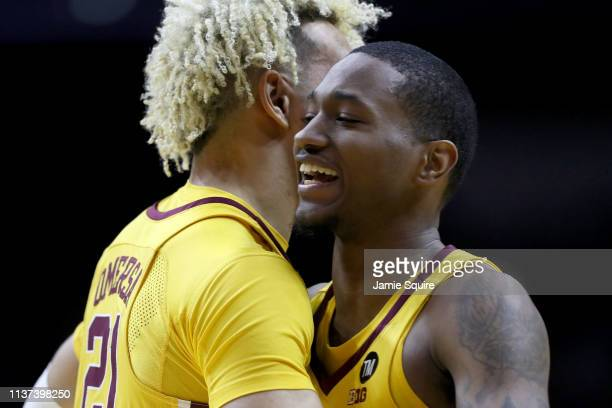 Dupree McBrayer and Jarvis Omersa of the Minnesota Golden Gophers react in the final moments of their 8676 win over Louisville Cardinals in the First...