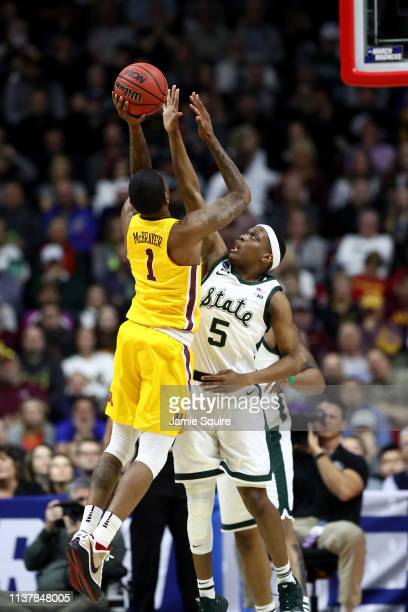 Dupree McBrayer of the Minnesota Golden Gophers shoots the ball against Cassius Winston of the Michigan State Spartans during the first half in the...