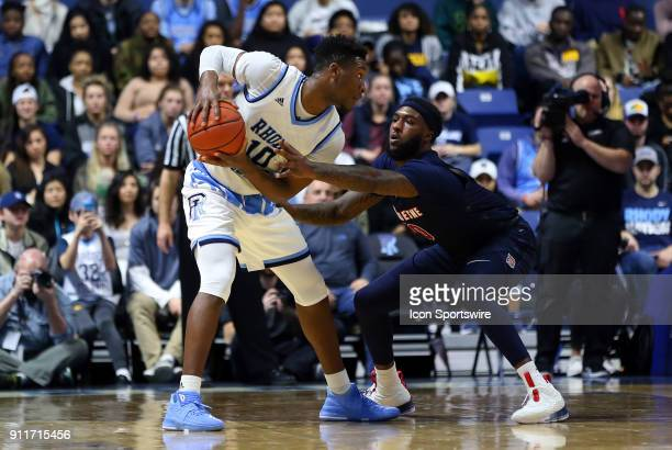 Duquesne Dukes forward Chas Brown defends Rhode Island Rams forward Cyril Langevine during a college basketball game between Duquesne Dukes and Rhode...