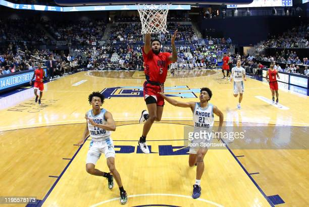 Duquesne Dukes forward Marcus Weathers drives to the basket as Rhode Island Rams guard Jeff Dowtin and Rhode Island Rams forward Jacob Toppin look on...
