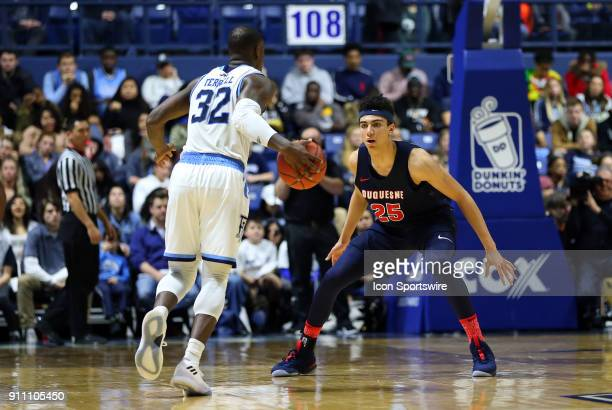 Duquesne Dukes forward Tydus Verhoeven defends Rhode Island Rams guard Jared Terrell during a college basketball game between Duquesne Dukes and...