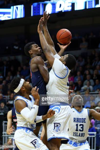 Duquesne Dukes guard Eric Williams Jr defended by Rhode Island Rams forward Andre Berry during a college basketball game between Duquesne Dukes and...