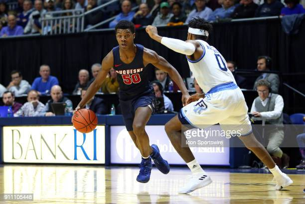 Duquesne Dukes guard Eric Williams Jr defended by Rhode Island Rams guard EC Matthews during a college basketball game between Duquesne Dukes and...