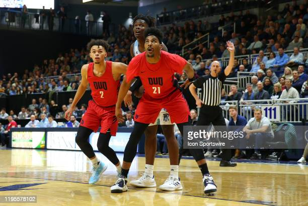 Duquesne Dukes guard Maceo Austin and Rhode Island Rams forward Jacob Toppin boxout Rhode Island Rams forward Jermaine Harris during a college...