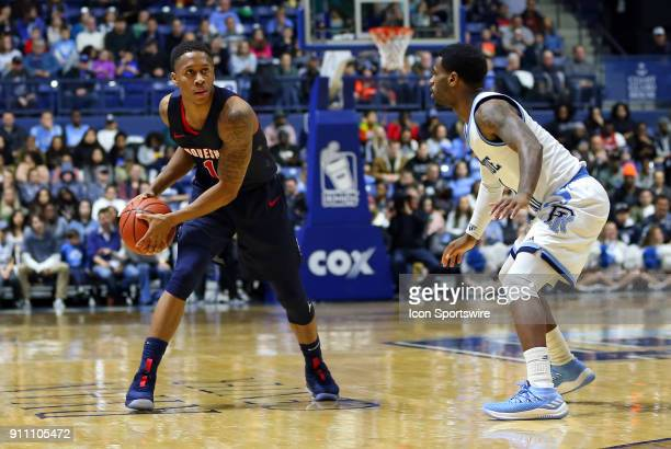 Duquesne Dukes guard Mike Lewis II and Rhode Island Rams guard Jarvis Garrett during a college basketball game between Duquesne Dukes and Rhode...