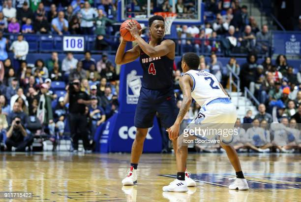 Duquesne Dukes guard Rene CastroCaneddy defended by Rhode Island Rams guard Fatts Russell during a college basketball game between Duquesne Dukes and...