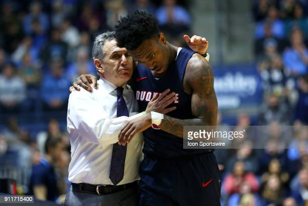 Duquesne Dukes head coach Keith Dambrot speaks with Duquesne Dukes guard Tarin Smith during a college basketball game between Duquesne Dukes and...