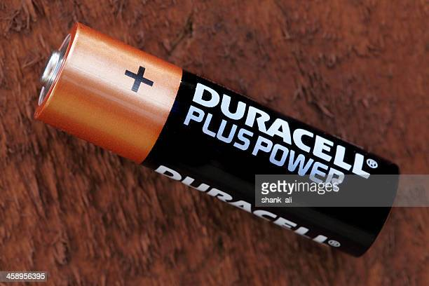 duracell plus aa battery - duracell stock pictures, royalty-free photos & images
