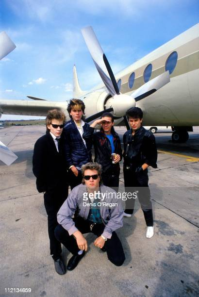 Duran Duran board a plane in the USA 1984
