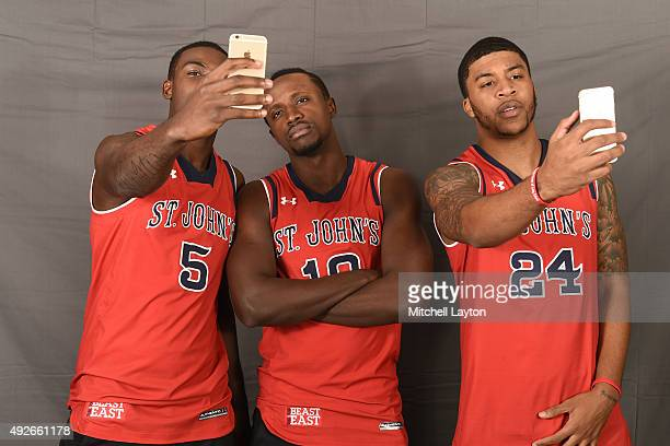 Durand Johnson Elijah Holifield and Ron Mvouika of the St John's Red Storm pose for photos during the Big East Men's Women's Basketball Media Day at...