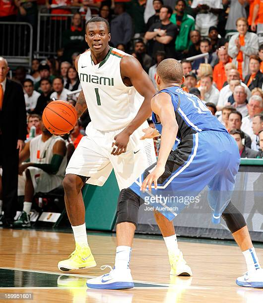Durand Scott of the Miami Hurricanes dribbles the ball against Rasheed Sulaimon of the Duke Blue Devils on January 23 2013 at the BankUnited Center...