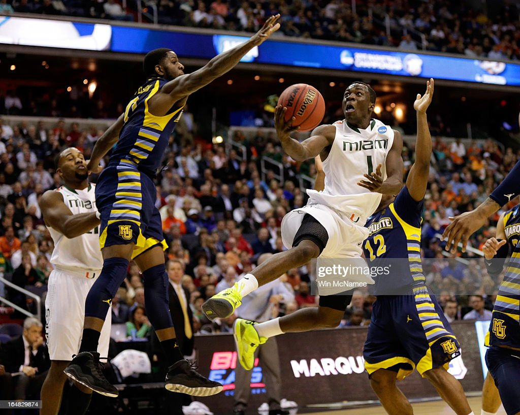 Durand Scott #1 of the Miami (Fl) Hurricanes goes to the hoop against Jamil Wilson #0 of the Marquette Golden Eagles during the East Regional Round of the 2013 NCAA Men's Basketball Tournament at Verizon Center on March 28, 2013 in Washington, DC.