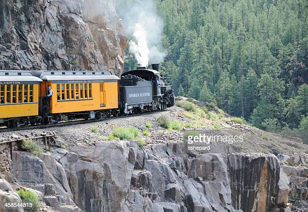 Durango and Silverton train rounding mountain curve