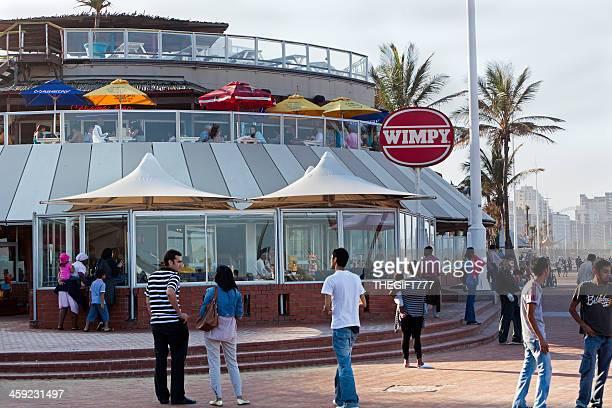 durban beach front restaurant - durban beach stock photos and pictures