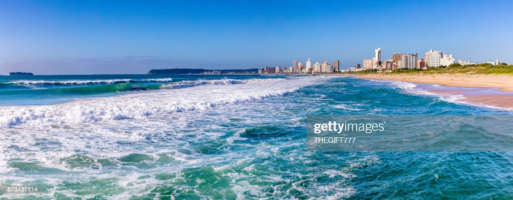 Durban Cityscape with the surf of the indian ocean : Stock Photo