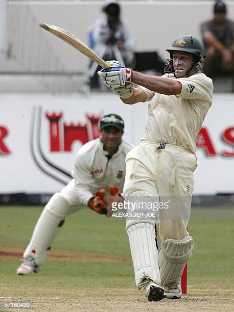 Australian batsman Mike Hussey plays a shot off South African bowler Shaun Pollock on the second day of the 2nd 5 day test match at Sahara Stadium...
