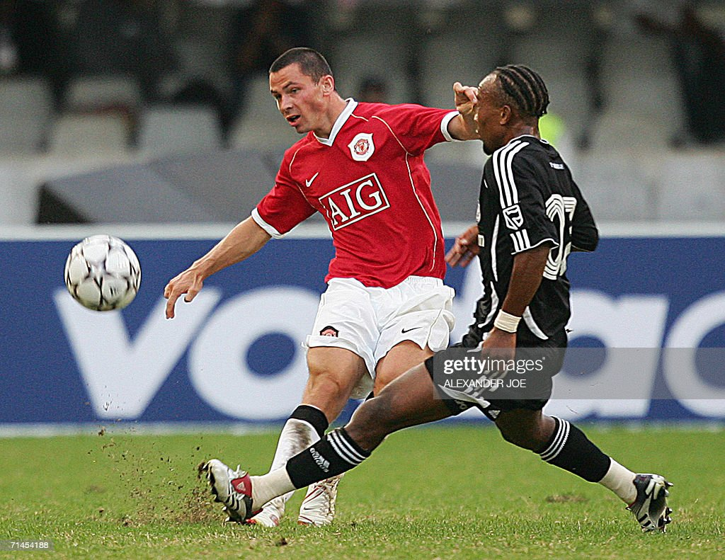 Englands manchester united phil bardsle pictures getty images englands manchester united phil bardsley gets the ball off gift leremi of orlando pirates during the negle Choice Image