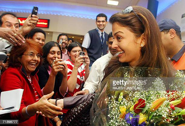 Indian Film actress Aishwarya Rai is cheered by fans as she arrives in Durban 08 July 2006 Rai a former Miss World and Miss Universe is in Durban to...