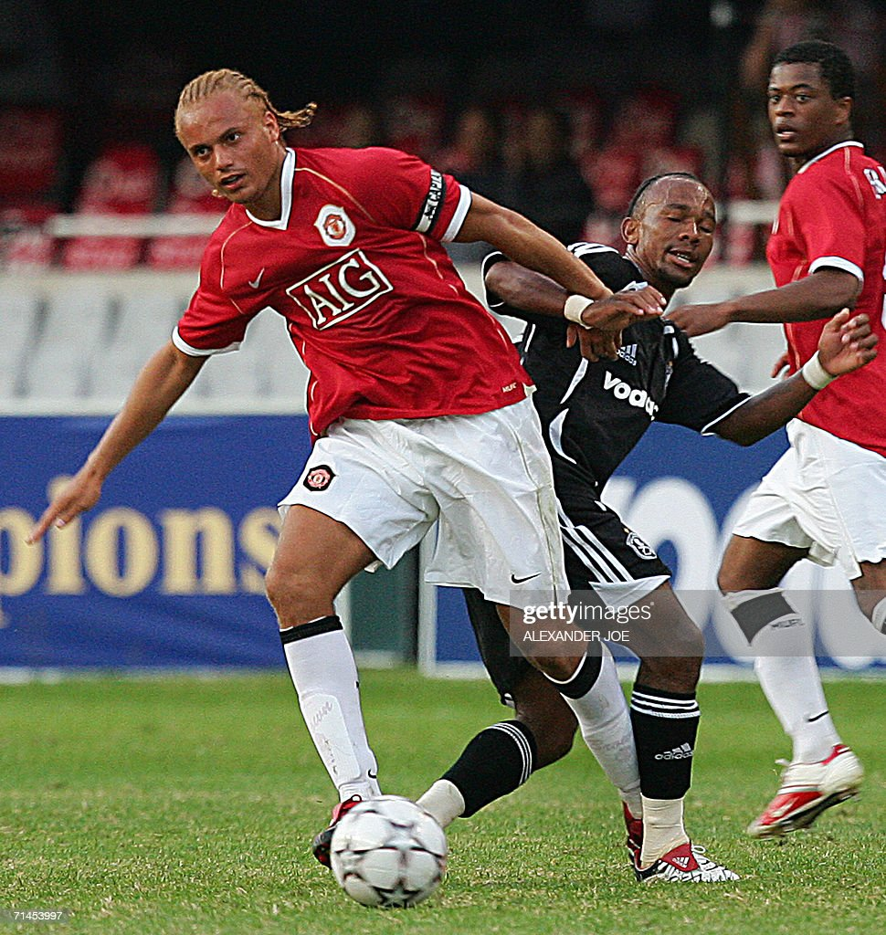 Manchester united player wes brown l g pictures getty images manchester united player wes brown l gets the ball off gift leremi of orlando negle Image collections