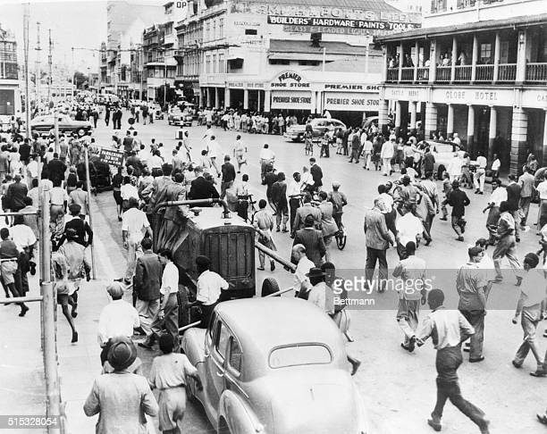 Race Riot Natives race through Durban's Pine Street seeking new victims at the height of the three day race riot between Africans and Indians...