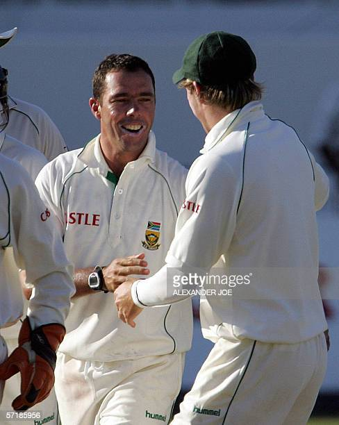 South African bowler Nicky Boje celeabrates getting out Australia's opening batsman Justin Langer during their 2nd innings on the third day of the...
