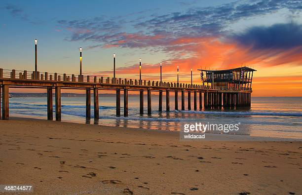 durban ushaka pier at sunrise - durban beach stock photos and pictures