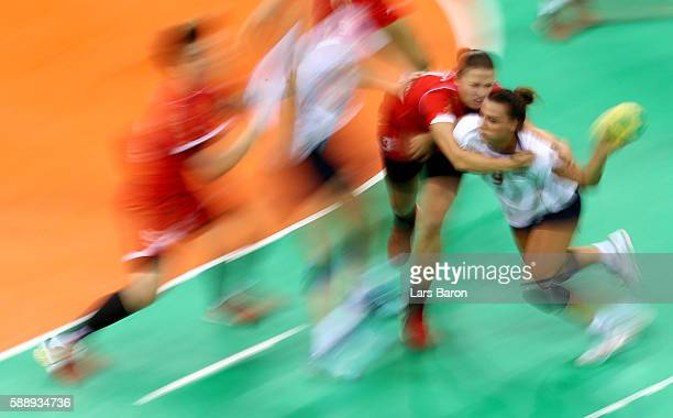Durdina Jaukovic of Montenegro challenges Nora Mork of Norway during the Womens Preliminary Group A match between Montenegro and Norway on Day 7 of...