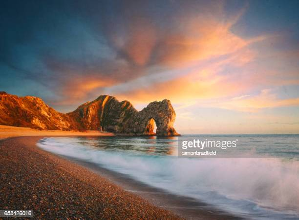durdle door composite - southwest england stock photos and pictures