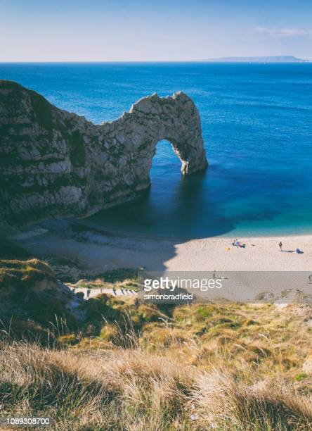 durdle door on dorset's jurassic coast - southwest england stock photos and pictures
