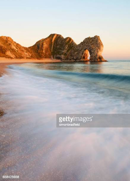 durdle door on the jurassic coast, uk - southwest england stock photos and pictures