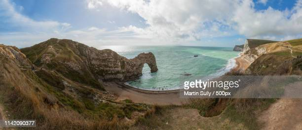 durdle door panoramic - stiches stock photos and pictures