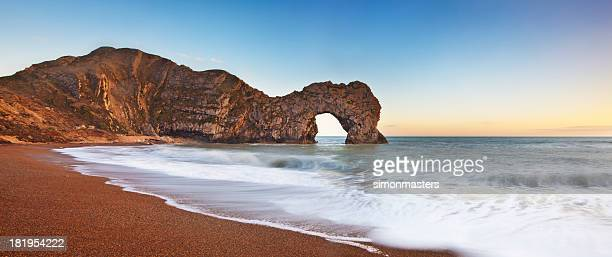 durdle door sunset - southwest england stock photos and pictures