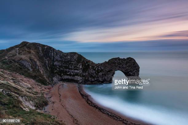 durdle door twilight - southwest england stock photos and pictures