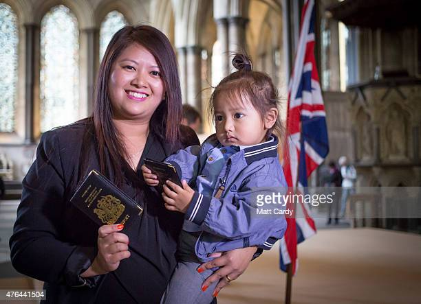 Durga Gurung and her son Shulabh pose for a photograph following a British citizenship ceremony in Salisbury Cathedral on June 9 2015 in Salisbury...