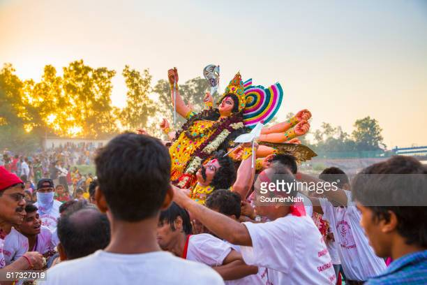 durga puja festival : the immersion day - durga stock photos and pictures
