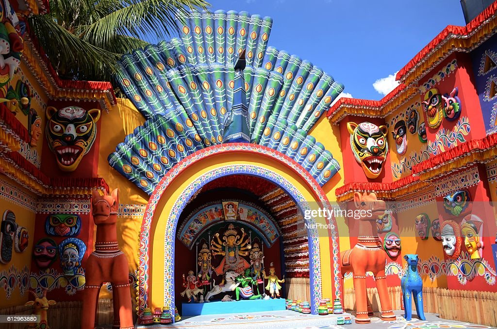 A Durga puja pandal decorated with colourful traditional masks and other 'Hindu' symbols using in new year celebration of Bangladesh in Kolkata India...
