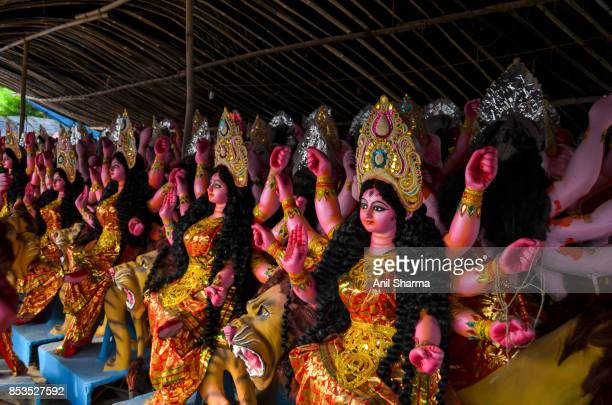 durga puja preparations- goddess durga and other hindu gods - durga stock photos and pictures