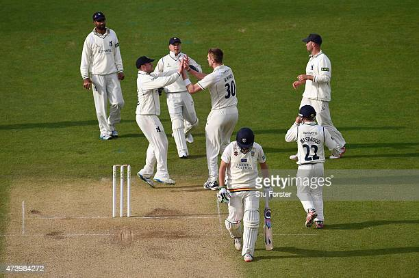 Durham batsman Calum MacLeod leaves the field dejectedly as Boyd Rankin celebrates his wicket with team mates during day three of the LV County...