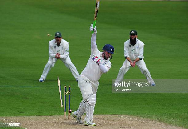 Durham batsman Ian Blackwell is bowled by Damien Wright during the second day of the LV County Championship Division One game between Worcestershire...