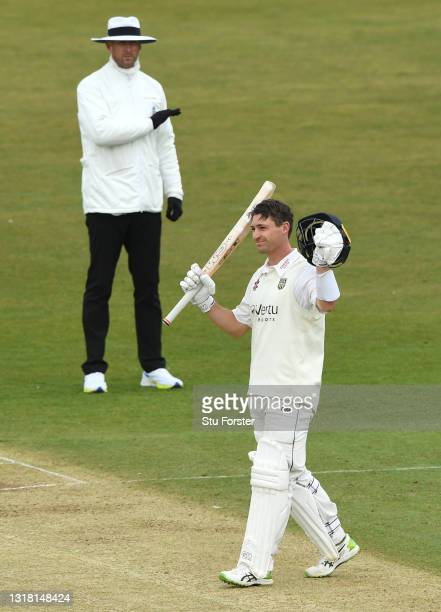 Durham batsman Will Young celebrates after reaching his century as umpire Michael Gough signals four runs during Day three of the LV= Insurance...