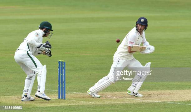 Durham batsman Will Young picks up some runs watched by wicketkeeper Ben Cox during Day three of the LV= Insurance County Championship match between...
