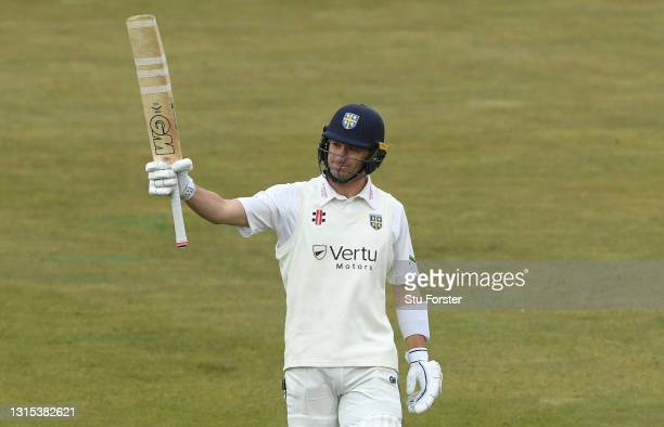 Durham batsman Will Young raises his bat after reaching his century during day two of the LV= Insurance County Championship match between Durham and...