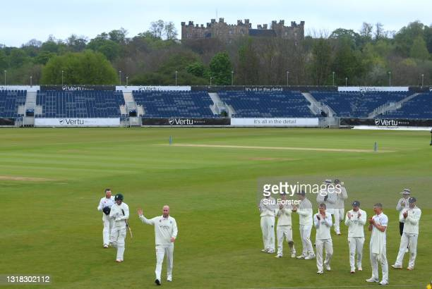 Durham bowler Chris Rushworth is applauded by team mates as the teams leave the field at tea after taking the wicket of Worcestershire batsman Jack...