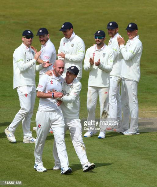 Durham bowler Chris Rushworth is congratulated by Captain Scott Borthwick and team mates after taking the wicket of Worcestershire batsman Jack...