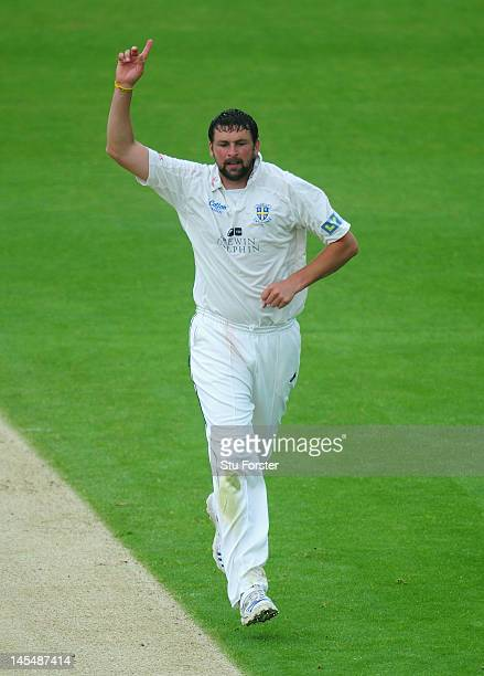 Durham bowler Steve Harmison celebrates the wicket of Kyle Hogg during day two of the LV County Championship division one match between Durham and...