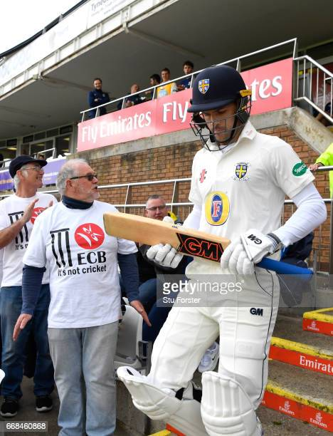 Durham opening batsmen Stephen Cook walks out to bat as Durham supporters with 'It's not cricket ECB' TShirts in protest at Durham's demotion to the...