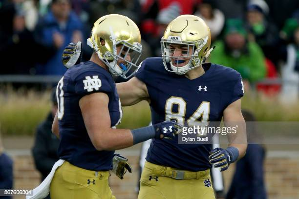 Durham Smythe and Cole Kmet of the Notre Dame Fighting Irish celebrate after scoring a touchdown in the first quarter against the North Carolina...